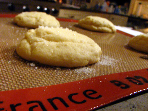 Close up of old-fashioned sugar cookies on a baking mat | Foodal