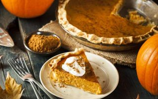 A slice of pumpkin and whole pie and fresh pumpkins in the background | Foodal