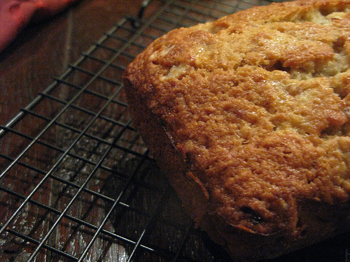 Top view of a loaf of banana bread on a cooling rack | Foodal