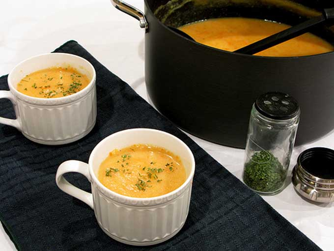 Oblique view of two mugs of potage parmentier potato soup | Foodal
