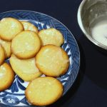 A plate of glazed lemon cookies on a black background | Foodal