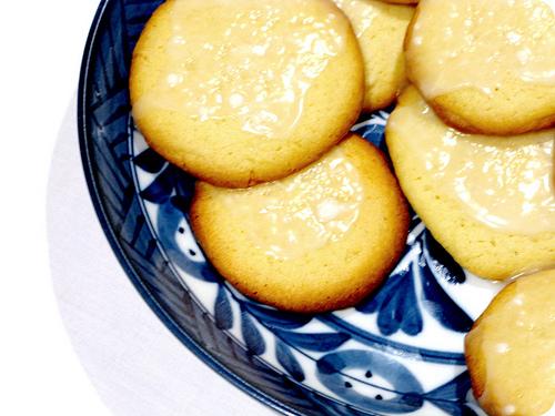 Top view of a plate of glazed lemon cookies   Fooal