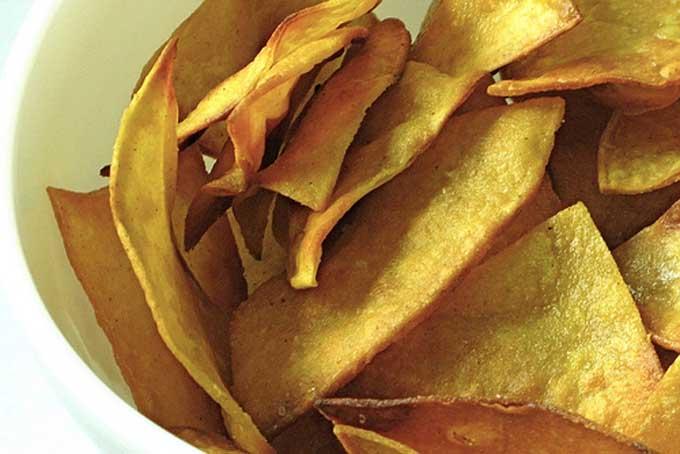 Close up view of homemade corn tortilla chips | Foodal