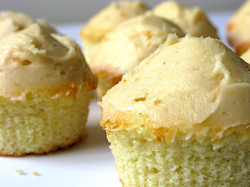 Side view of Vanilla Muffin Cupcakes with Salted Caramel Frosting | Foodal