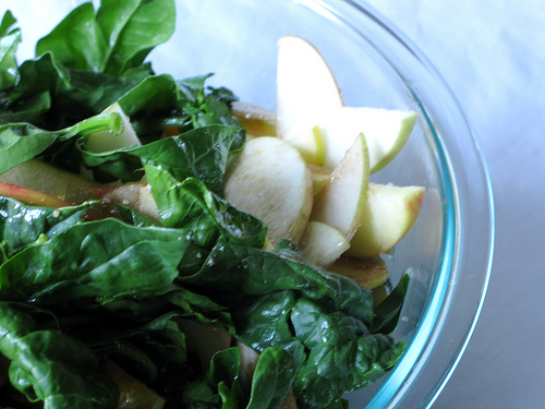 Close up of a bowl of spinach salad | Foodal