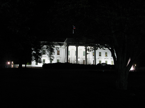 The outside of the White House at night.