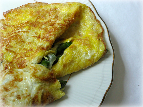 Asparagus and Mozzarella Omelette on a white, ceramic plate | Foodal