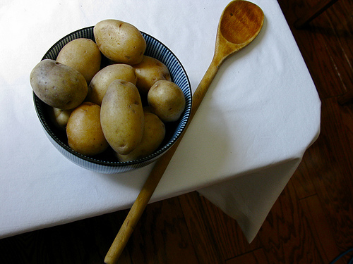 Top view of raw potatoes in a wooden bowl | Foodal