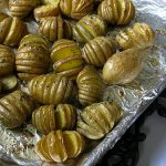Cooked Saged Hasselback potatoes on a baking sheet   Foodal