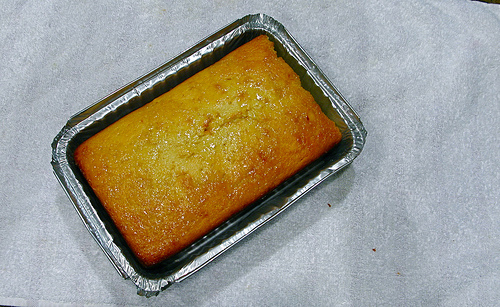 Top down view of a lemon yogurt cake in a baking pan | Foodal