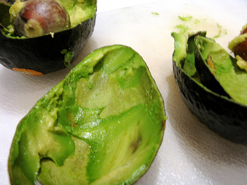 A ripe avocado cut open to reveal a softened interior | Foodal