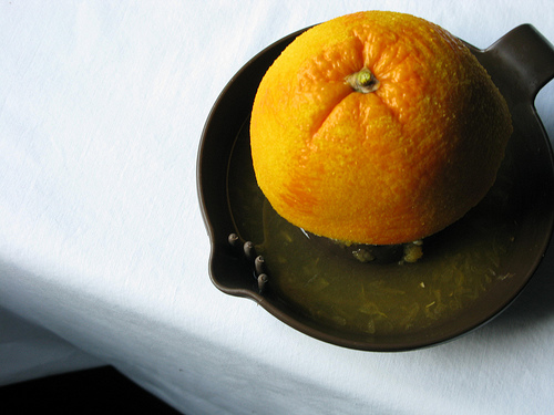 A large orange sitting on a serving pan | Foodal