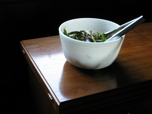 Oblique view of an asparagus salad in a white porcelain servicing bowl | Foodal