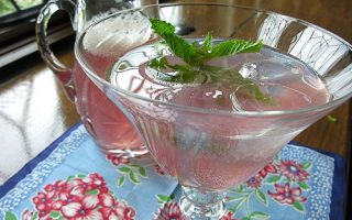 Delicious pink pomegranate lemonade topped with fresh mint.