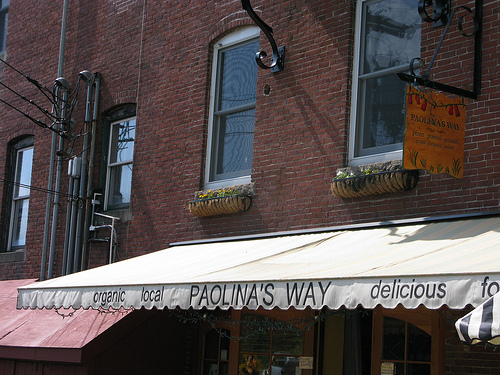 An image of signage of a restaurant named Paolina's Way.