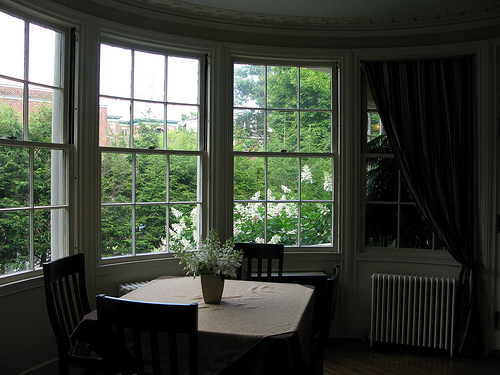 A cozy image of a breakfast nook with a picturesque view of the garden.