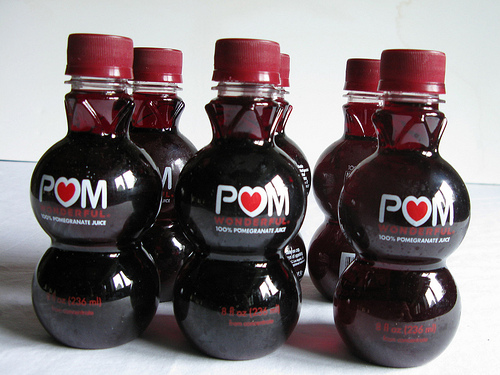 A close up view of bottles of pomegranate juice.