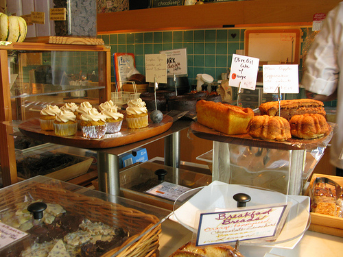 An array of various breads and pastries in a bakeshop.