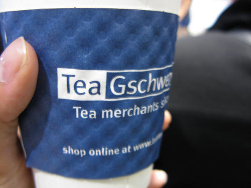 A close up image of a disposable cup that is labeled for tea.