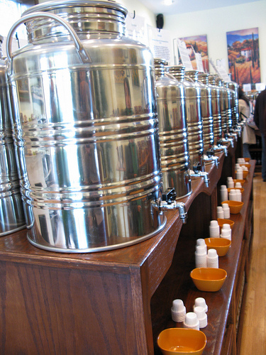 Big vats filled with various samples of extra virgin olive oils and amazing balsamic vinegars.