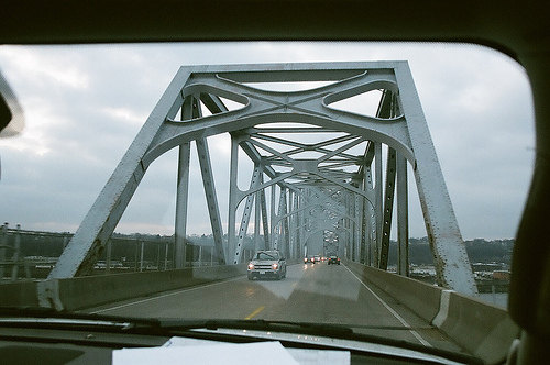An image of a bridge taken from the front of a vehicle.