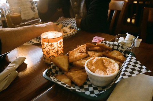 A tray of delicious food, placed on top of a checkered napkin.