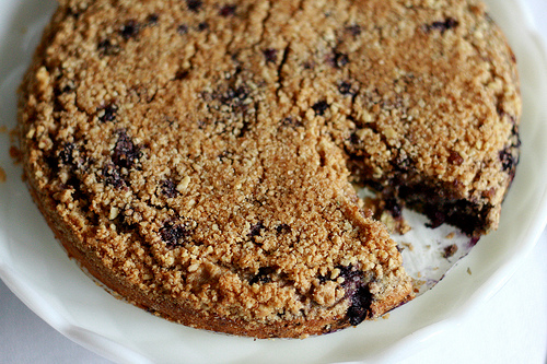 A top view image of a delicious blueberry coffee cake.