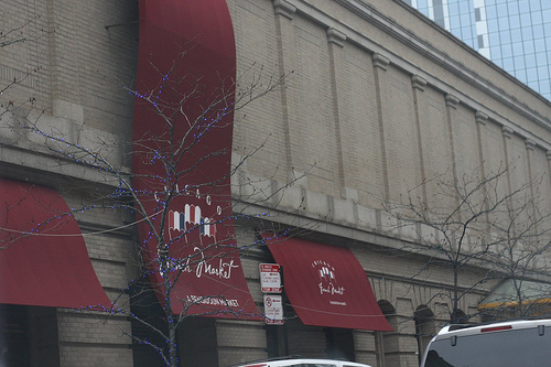 An image of the facade of the Chicago French Market.