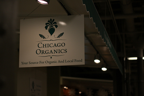 An image of a hanging signage named Chicago Organics.