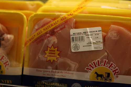 A number of packaged chicken meats for sale.