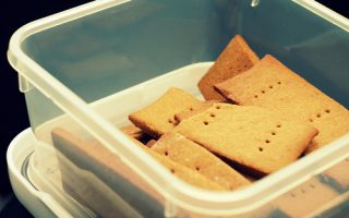 An image of graham crackers in a plastic container.