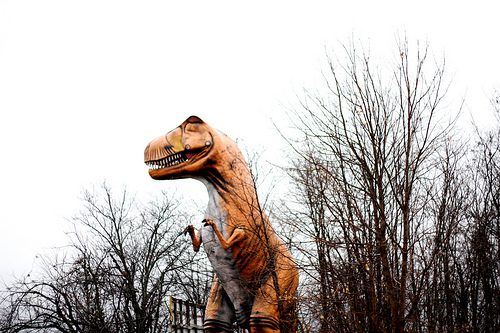 An image T-rex model looming over the trees.