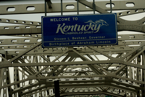 A welcome signage of Kentucky over a bridge.