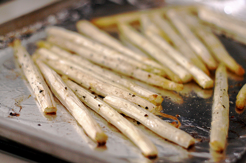 A close up view of baked white asparagus.