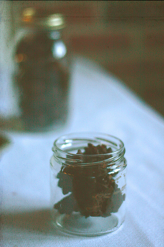 An image of jars filled with chocolate crunchies,