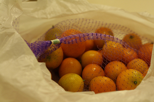 An image of a bag of kumquats in a plastic.
