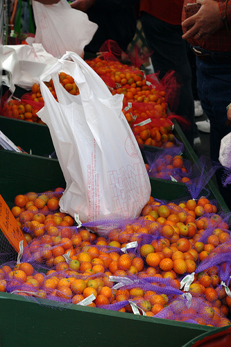 An image showing numerous bags of kumquats for sale.