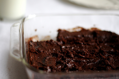 A close up view of delicious brownies in a baking pan.