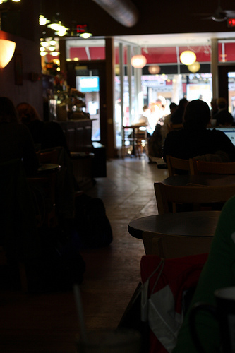 An image showing the interior of a cafe with customers.