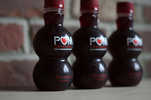 An image of three bottles of delicious pom juice.