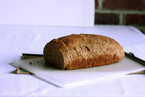 An image of beautiful whole grain on top of a white chopping board.