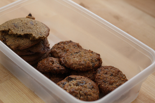 An image of a plastic container filled with delicious cookies.