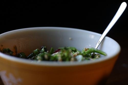 A close up image of a bowl of asparagus salad ready for eating.