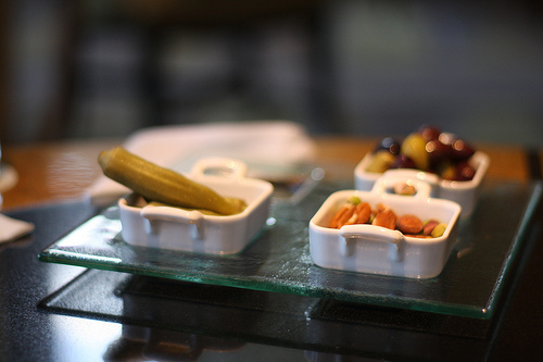 A close up image of various small servings of side dishes.