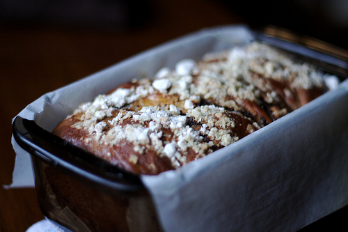 An image of a chocolate babka in a bread pan still warm from the oven.