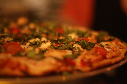 A close up image of a delicious pizza still warm from the oven.
