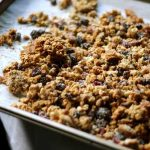 Homemade Oatmeal Cookie Granola on a a metal baking tray.