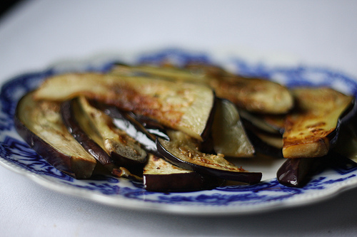 An image of a plateful of fried eggplant sliced thinly.