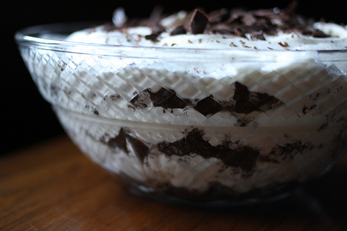 A glass bowl filled with the chocolate trifle.