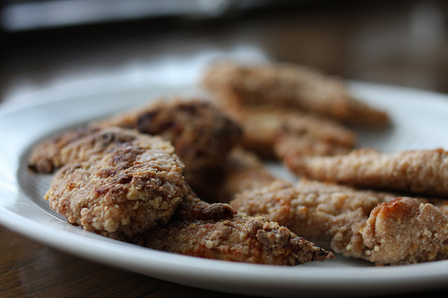 A close up image of crunchy and savory chicken fingers.